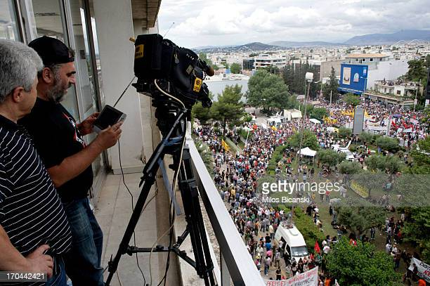 Employees of the state broadcaster ERT work during an online news bulletin broadcast at the corporation's headquarters during a 24hour general strike...