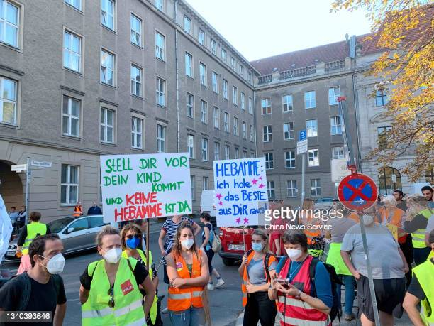 Employees of the state-owned Berlin hospitals Vivantes and Charite march during a demonstration in front of the Charite building on September 14,...