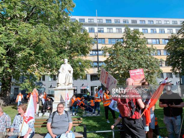 Employees of the state-owned Berlin hospitals Vivantes and Charite sit around statue of German microbiologist Robert Koch during a demonstration in...