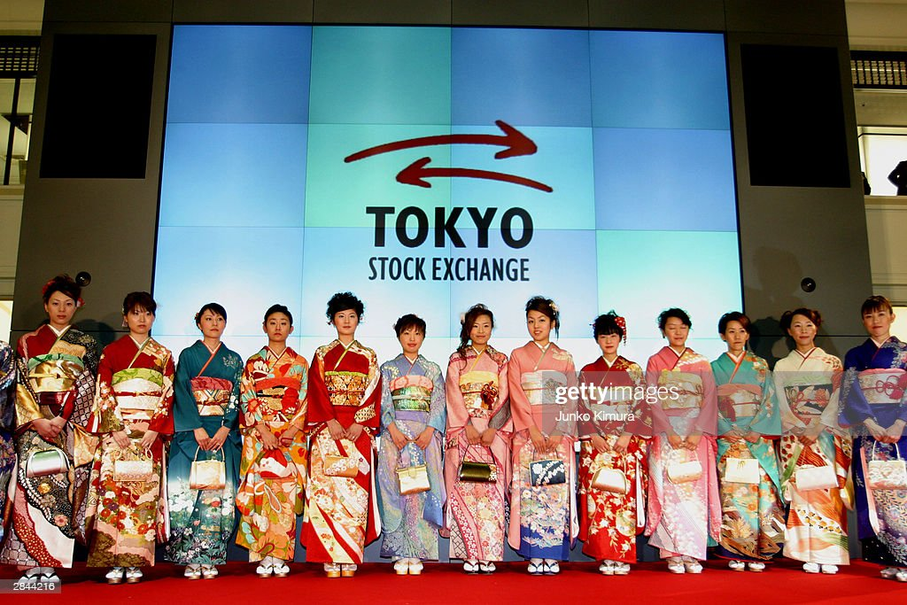 Employees of the Tokyo Stock Exchange, wearing traditional Japanese Kimonos, stand in front of an electric signage board January 5, 2004 in Tokyo, Japan. The Tokyo Stock Exchange opened today for the first time in 2004 after closing December 30, 2003 for the new year holiday. The nikkei stock average increased by 111.19 points, or approximately 1.04 percent and marked 10,787.83 points at the start of the trading.
