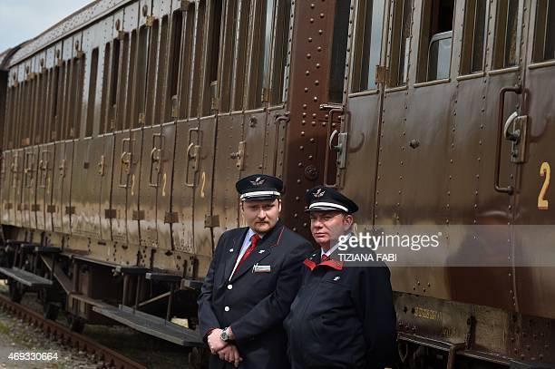 Employees of the Tuscany's Nature train pose at the Torrenieri Montalcino station on April 11 2015 Italian Culture Minister Dario Franceschini...