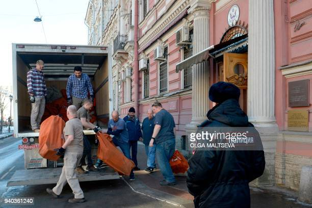 Employees of the US Consulate and removal men load in a truck belongings and objects of the US Consulate in Saint Petersburg on March 31, 2018....