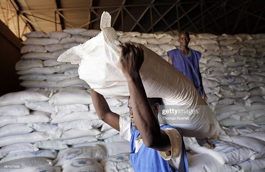 Employees of the World Food Programme, WFP, carrying sacks of basic