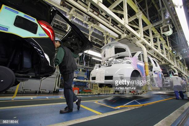 Employees of Toyota Motor Corporation work during the assembly process at the company's Takaoka Plant on December 2 2005 in Toyota Aichi Prefecture...