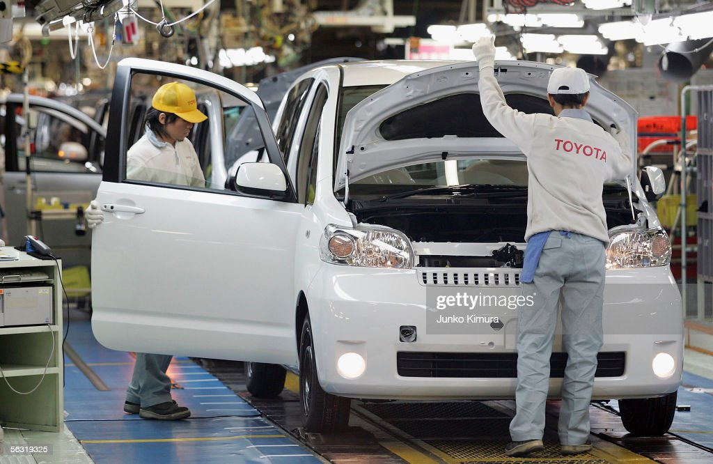 Employees of Toyota Motor Corporation work during the assembly process at the company's Takaoka Plant on December 2, 2005 in Toyota, Aichi Prefecture, Japan. 640,000 passenger cars were produced at Takaoka Plant in 2004.