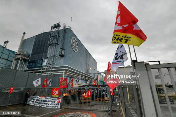 Employees of US giant General Electric block the main entrance of Belfort plant eastern France on October 10 2019 The management of General Electric...