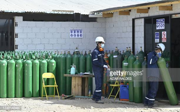 Employees of Valle Alto Medical Oxygen plant work with oxygen tanks in Arbieto municipality, 50 km from Cochabamba, on May 27, 2021.