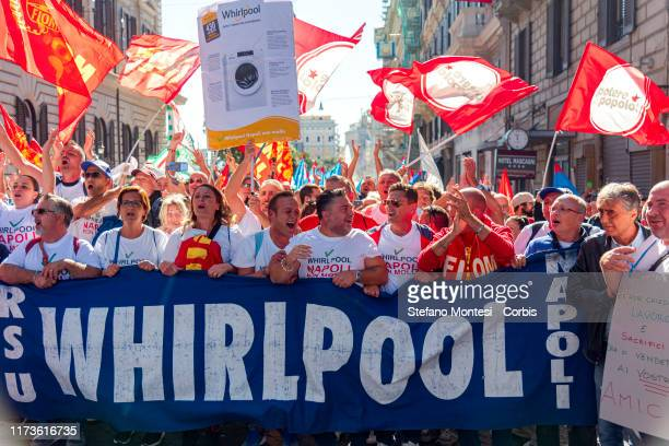 Employees of Whirlpool headquarters in Naples, which manufactures high-end washing machines, demonstrate against the plan to sell the Naples factory...