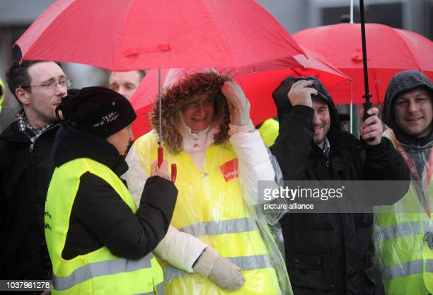 Employees on a strike stand in front of the entrance to the logistics center 'FRA1' of the online retailer Amazon in Bad Hersfeld Germany 19 December...