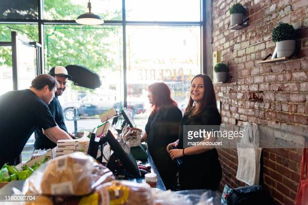 employees opening small zero waste oriented grocery store. - local produce stock pictures, royalty-free photos & images