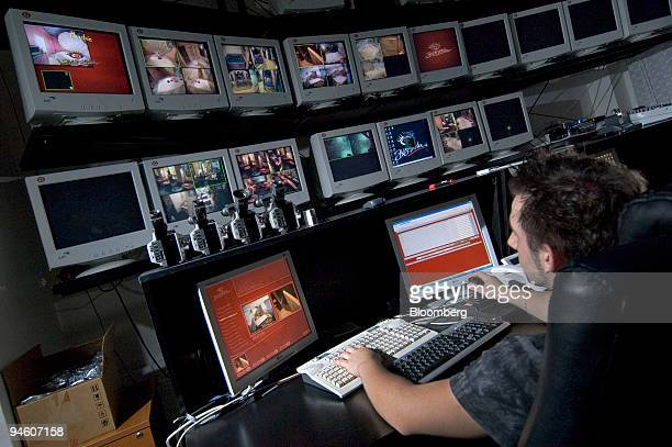Employees operate computers in a control room at Big Sister an online erotic club in Prague Czech Republic on Tuesday Oct 2 2007 In Prague the...