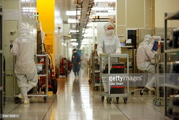 Employees operate in the wafer FAB of Semiconductor Manufacturing International Corp in Shanghai China on 18 February 2011 The Taiwan based...