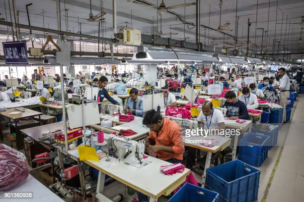 Employees operate sewing machines at a Rajlakshmi Cotton Mills Ltd garment factory in Kolkata West Bengal India on Monday Dec 25 2017 India is due to...