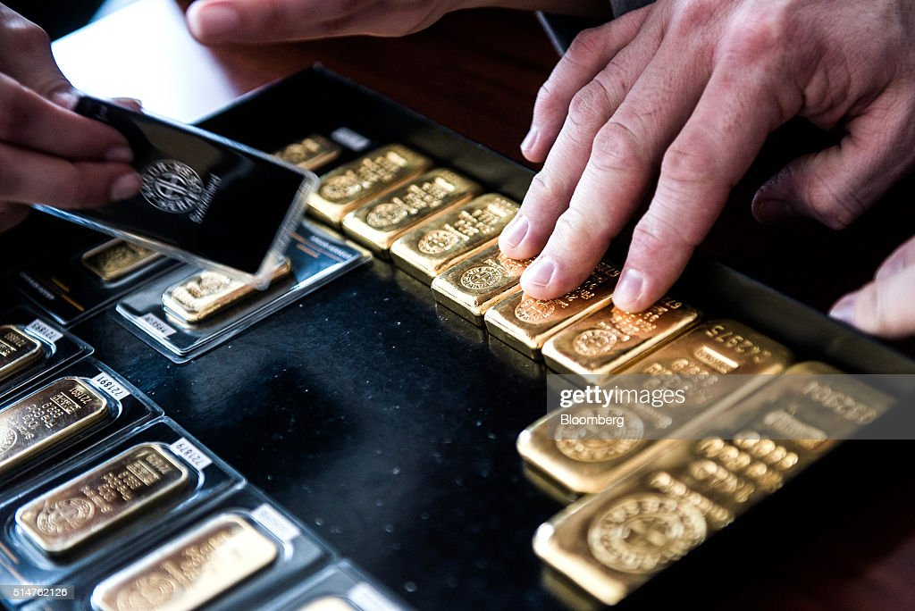 Employees organize mixed rate gold bars in this arranged photograph at Solar Capital Gold Zrt. in Budapest, Hungary, on Thursday, March 10, 2016. Gold advanced to the highest level in a year after the European Central Bank indicated it wouldn't cut interest rates further, boosting the euro and making dollar-denominated bullion less expensive for investors. Photographer: Akos Stiller/Bloomberg via Getty Images
