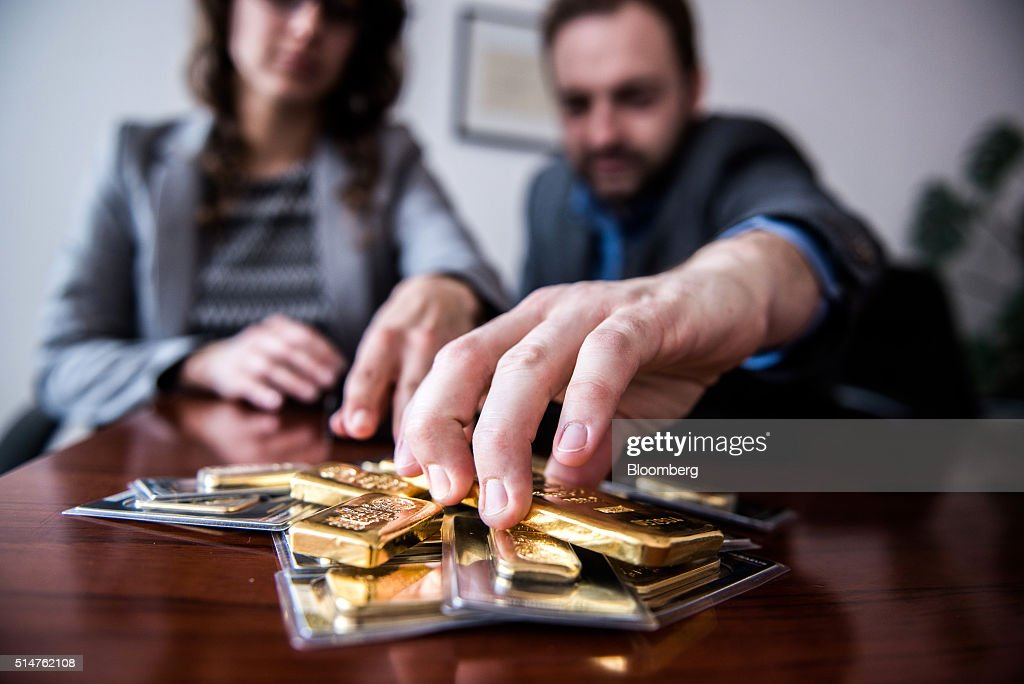 Employees organize mixed weight gold bars in this arranged photograph at Solar Capital Gold Zrt. in Budapest, Hungary, on Thursday, March 10, 2016. Gold advanced to the highest level in a year after the European Central Bank indicated it wouldn't cut interest rates further, boosting the euro and making dollar-denominated bullion less expensive for investors. Photographer: Akos Stiller/Bloomberg via Getty Images