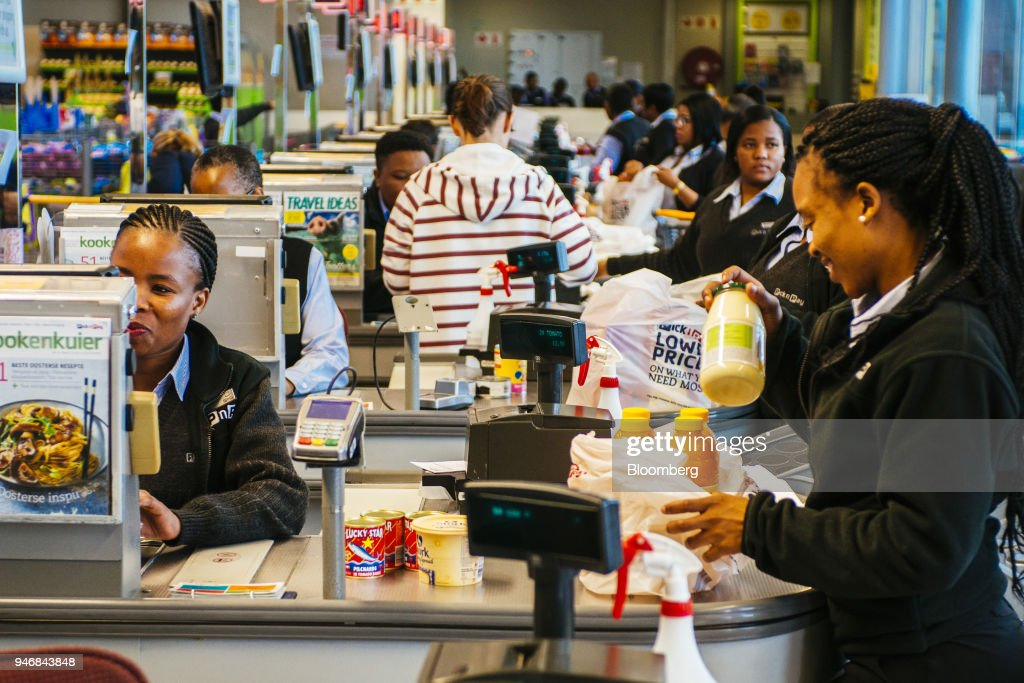 Employees pack bags of shopping at the check out area inside a Pick n Pay Stores Ltd. supermarket in Johannesburg, South Africa, on Monday, April 9, 2018. As trade tensions and the Syrian conflict roiled markets this month, South Africas rand has been stuck in an unusually narrow range for one of the worlds most volatile currencies. Photographer: Waldo Swiegers/Bloomberg via Getty Images