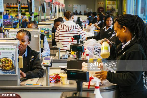 Employees pack bags of shopping at the check out area inside a Pick n Pay Stores Ltd supermarket in Johannesburg South Africa on Monday April 9 2018...