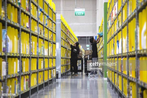 Employees pack orders at Amazoncom Inc's Amazon Prime Now fulfillment center in Singapore on Thursday July 27 2017 Amazon is kicking off in Singapore...