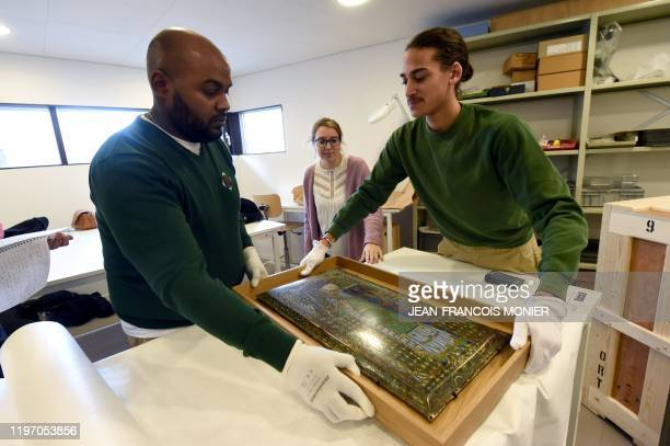 Employees pack the Plantagenet enamel representing Geoffroy V le Bel Count of Anjou and Maine Duke of Normandy founder of the Plantagenet dynasty in...