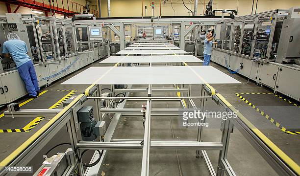 Employees perform a regular cleaning on the production line at the Suntech Power Holdings Co Ltd facility in Goodyear Arizona US on Monday June 18...