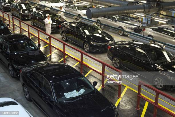 Employees perform quality control inspections on 2018 Honda Accord vehicles before being driven off the assembly line at the Honda of America...
