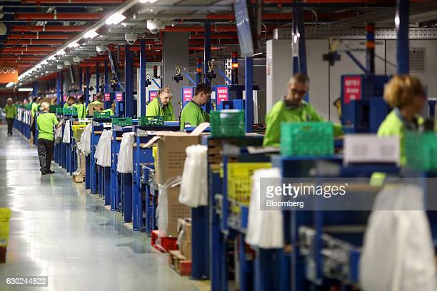 Employees pick orders at the Ocado Group Plc distribution centre in Dordon UK on Friday Dec 16 2016 Ocado provides home delivery of a wide range of...