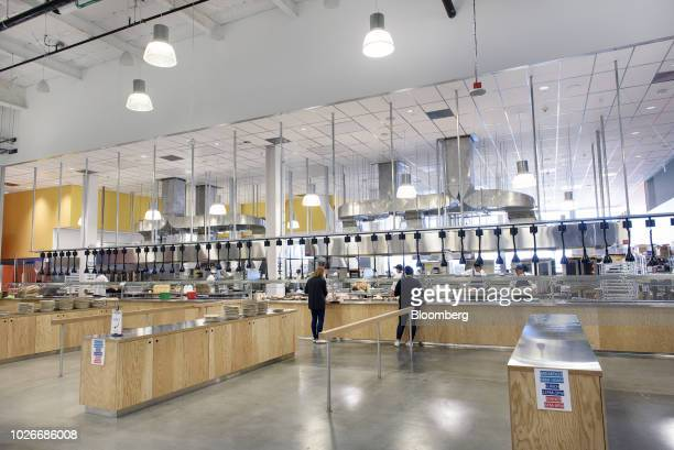 Employees pick up food at the Urban Cafe dining area inside the new Facebook Inc. Frank Gehry-designed MPK 21 office building in Menlo Park,...
