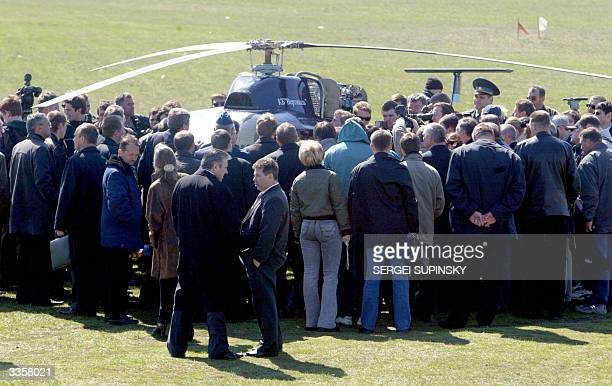 Employees pilots and media surround the first Ukrainian serial helicopter Angel during its presentation 14 April 2004 near Kiev The helicopter Angel...