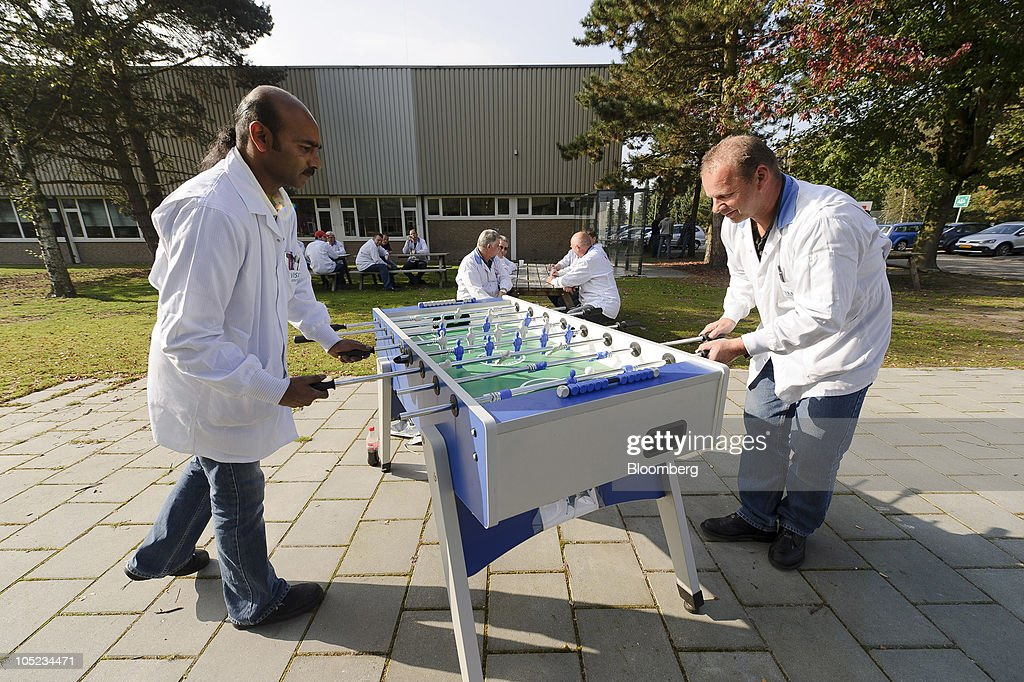 Employees play a game of foosball during a break at the Philips Healthcare production facility c&us : philips lighting healthcare - azcodes.com