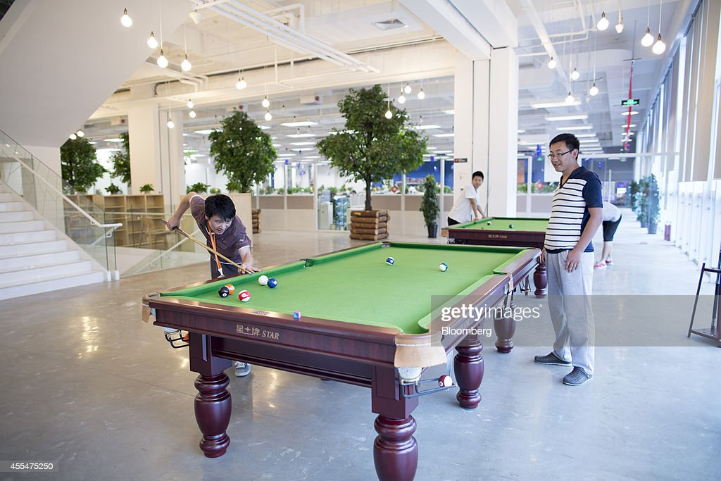 Employees play games of pool inside a Xiaomi Corp. office in Beijing, China, on Friday, Sept. 12, 2014. Xiaomi Chief Executive Officer Lei Jun plans to boost global smartphone sales fivefold to 100 million units next year. Photographer: Brent Lewin/Bloomberg via Getty Images