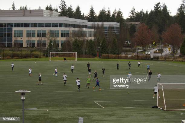Employees play soccer at the Microsoft Corp main campusin Redmond Washington US on Tuesday Dec 19 2017 In the race to commercialize a new type of...
