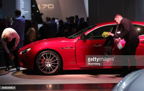 Employees polish a Maserati GranTurismo luxury automobile manufactured by Maserati SpA during the first media preview day of the IAA Frankfurt Motor...