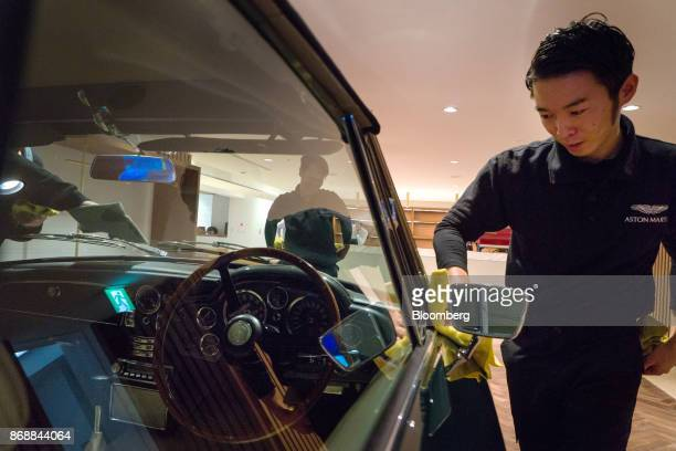 Employees polish the body of an Aston Martin Lagonda Ltd DB6 Mk2 Volante automobile in Tokyo Japan on Wednesday Nov 1 2017 The luxury sportscar maker...