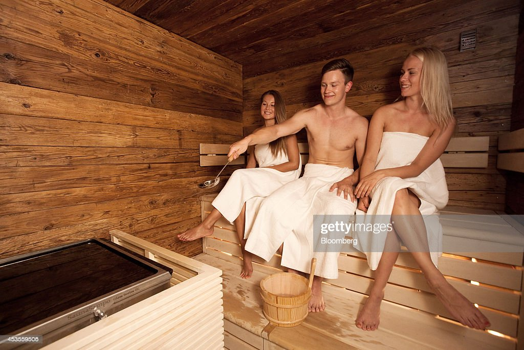 Employees pose for a photograph in the sauna for Finnair ...