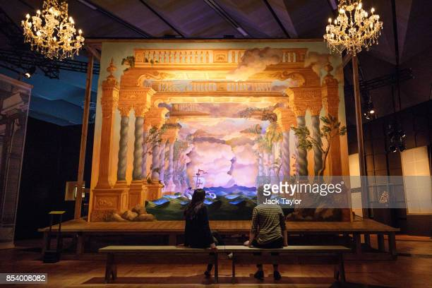 Employees pose in front of 'Il Vostro Maggio' a Scenographic installation inspired by the original stage directions of Rinaldo at the Victoria and...
