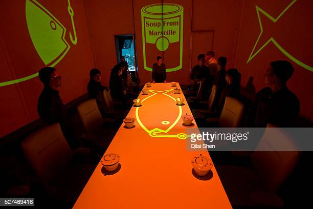 Employees practice serving patons at Chef Paul Pairet's Ultra Violet restaurant in Shanghai, China on 28 September 2013. Serving only a dozen patrons...