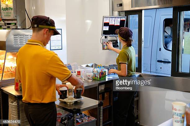 Employees prepare a customer's drivethru food order inside a McDonald's Corp restaurant in Manchester UK on Monday Aug 10 2015 McDonald's Chief...