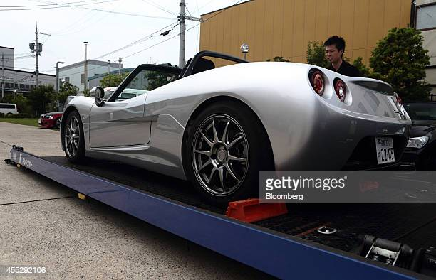 Employees prepare a GLM Co Tommykaira ZZ electric vehicle for a test drive at the company's RD facility in Uji Kyoto Prefecture Japan on Tuesday Aug...