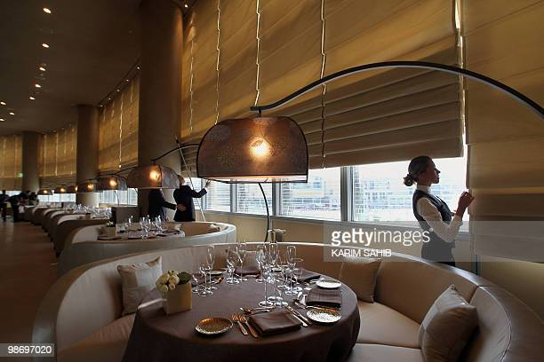 Employees prepare a restaurant for opening at the Dubai's Armani hotel in the Gulf emirate's Burj Khalifa tower on April 27 just before the hotel's...
