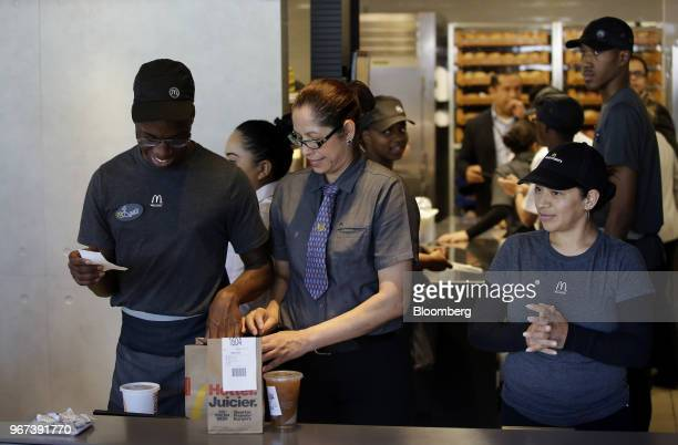 Employees prepare an order at the restaurant inside the new McDonald's Corp headquarters in Chicago Illinois US on Monday June 4 2018 McDonald's CEO...