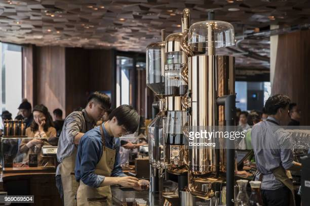 Employees prepare beverages inside the Starbucks Corp Reserve Roastery store in Shanghai China on Friday May 11 2018 Starbucksis laying out an...