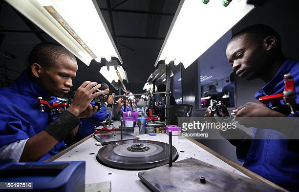 Employees prepare diamonds for polishing on a polishing wheel at the Shrenuj Botswana Ltd sightholder office in Gaborone Botswana on Thursday Oct 25...