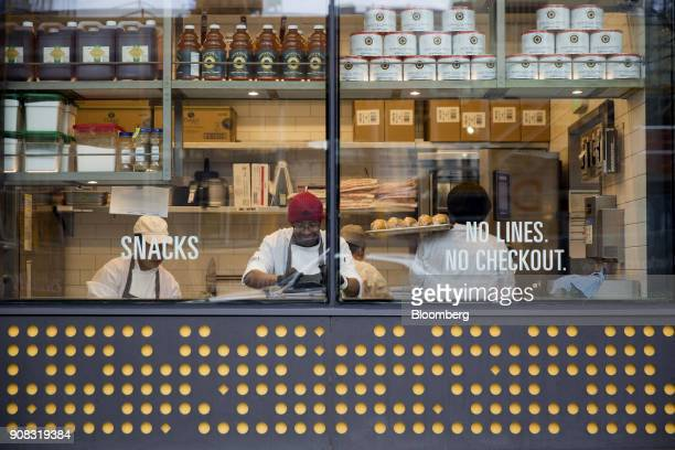 Employees prepare fresh food items at the Amazon Go store in Seattle Washington US on Wednesday Jan 17 2018 After more than a year of testing with an...