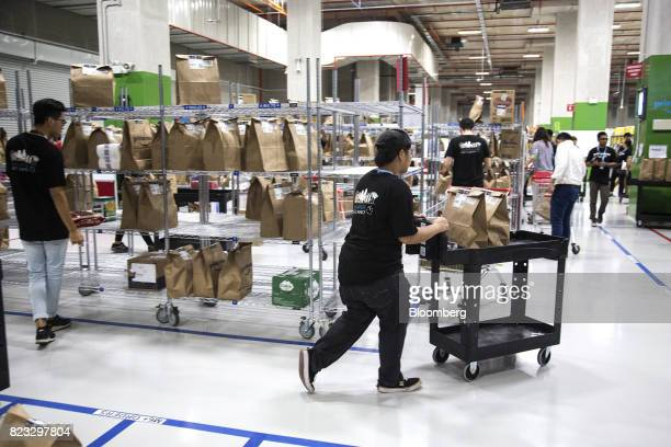 Employees prepare orders for shipping at Amazoncom Inc's Amazon Prime Now fulfillment center in Singapore on Thursday July 27 2017 Amazon is kicking...