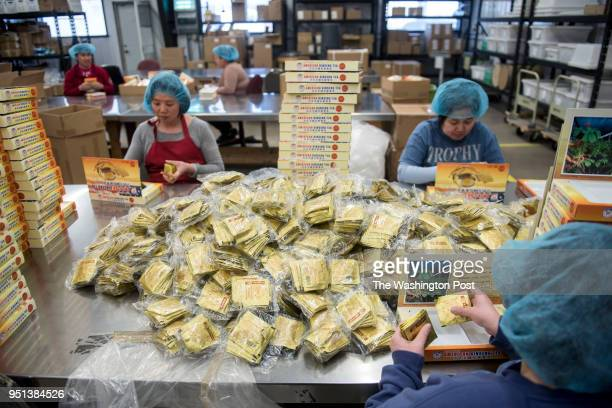 Employees prepare packages of tea at Hsu's Ginseng Enterprise in Wausau Wisconsin Monday April 9 2018