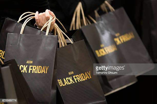 Employees prepare shopping bags during the Black Friday sale at an Aeon supermarket on November 25 2016 in Tokyo Japan Japan's largest retailer Aeon...