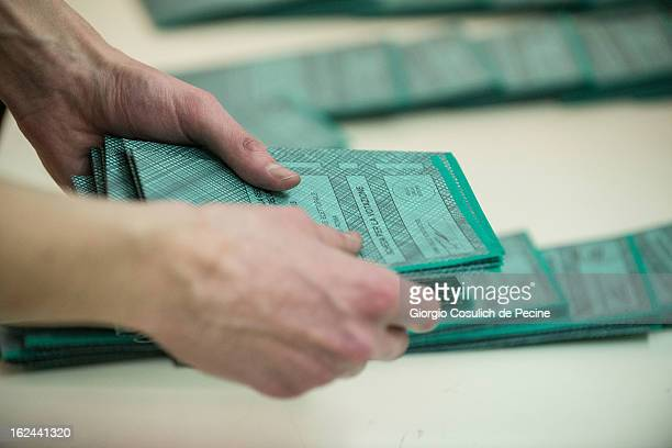 Employees prepare the ballots at a polling station on February 23 2013 in Rome Italy Italians go to the polls February 24 and 25 to replace Prime...
