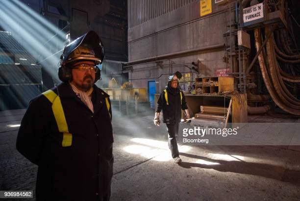 Employees prepare to take a sample from the electric arc furnace at Liberty Steel's Aldewerke mill in Rotherham UK on Wednesday March 21 2018 Most...