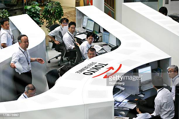 Employees prepare to work on the trading floor of Japan Exchange Group Inc's Tokyo Stock Exchange prior to the opening of the morning session in...