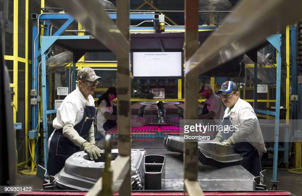 Employees pull and stack inner door frames during production at the Honda of America Manufacturing Inc Marysville Auto Plant in Marysville Ohio US on...